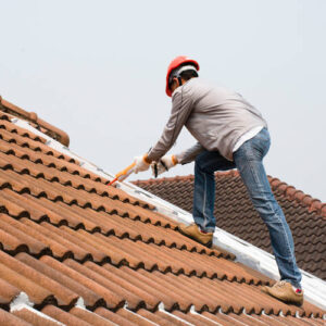 Man laying roof tiles